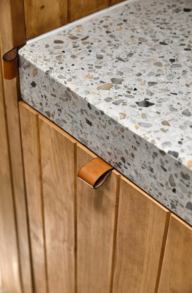 Wood panelled doors with terrazzo counters