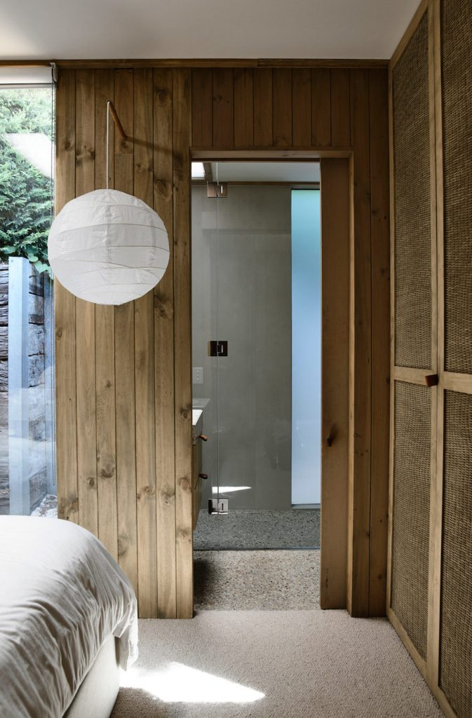 Bedroom through to ensuite with paper lantern and wooden panels
