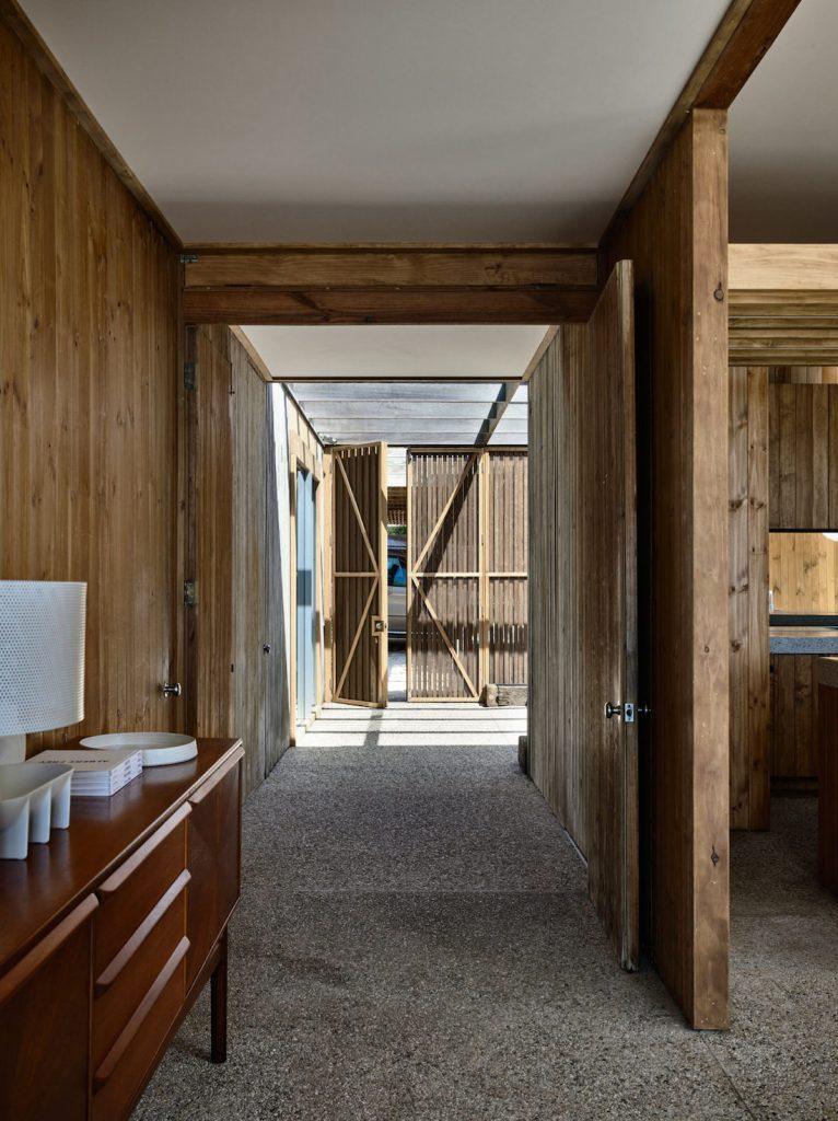 Timber panelled hallway with pebble crete flooring