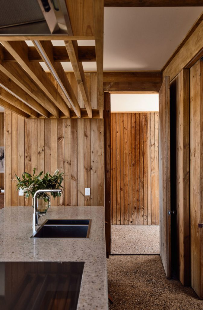 Timber panelled walls and batten roof in kitchen