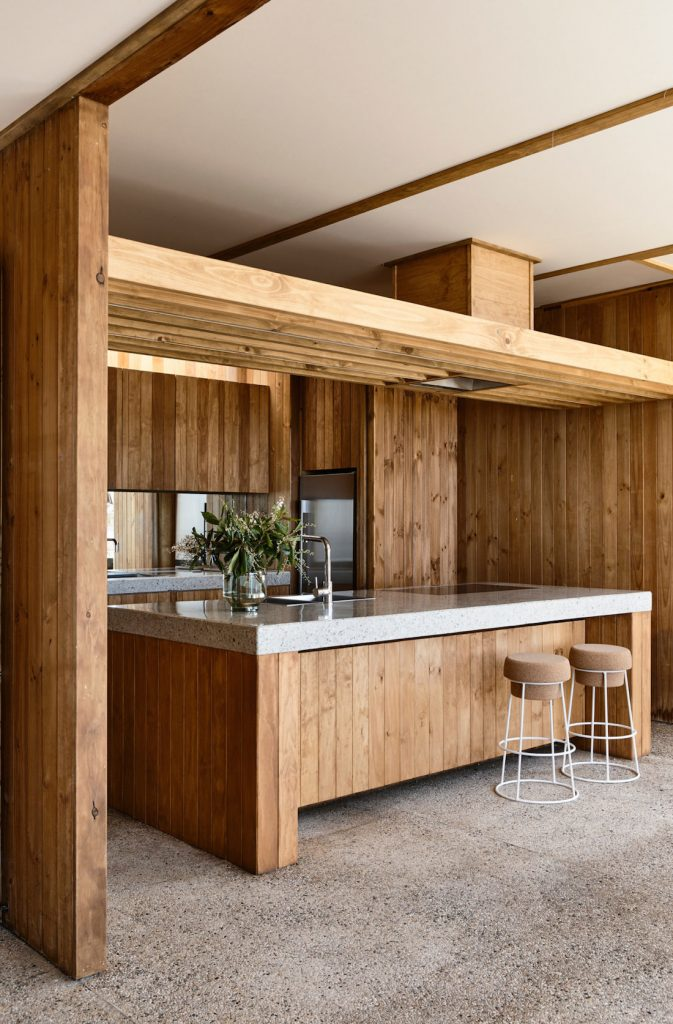 Timber kitchen with terrazzo counters and pebble crete floor
