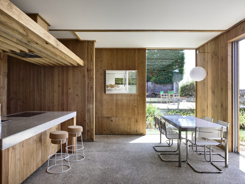 Timber kitchen and dining with pebble crete flooring