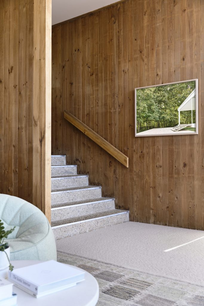 Timber panelled walls and pebble crete stairs