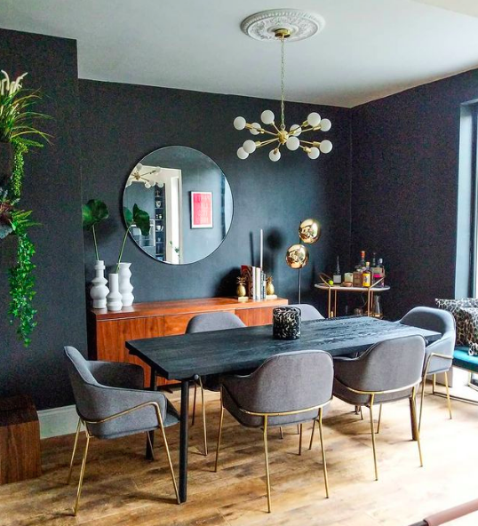 Black feature wall in eclectic vintage dining room