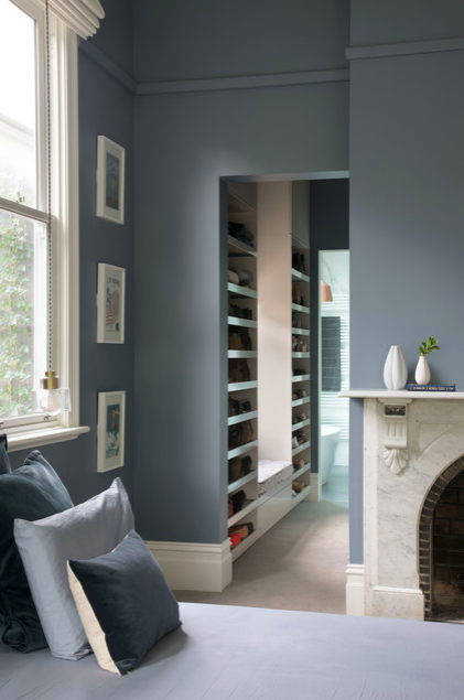 Grey blue walls in bedroom of Victorian home