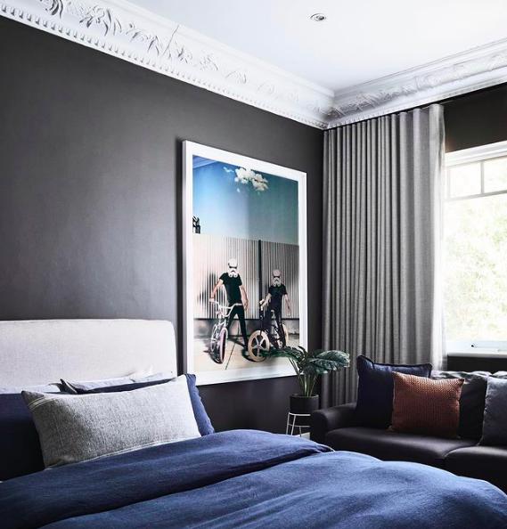 Grey bedroom for tween boy with Star Wars art