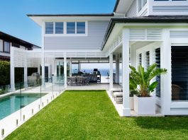 Coastal Australian Hamptons home facade with pool