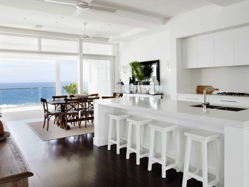 Coastal Hamptons home kitchen and dining space