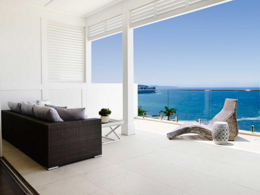 Coastal Hamptons home balcony with ocean view