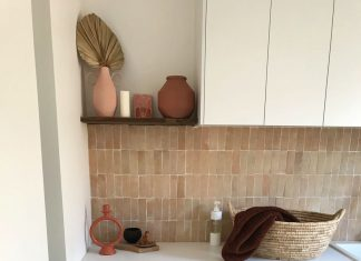 Modern Mediterranean laundry with pink feature tile