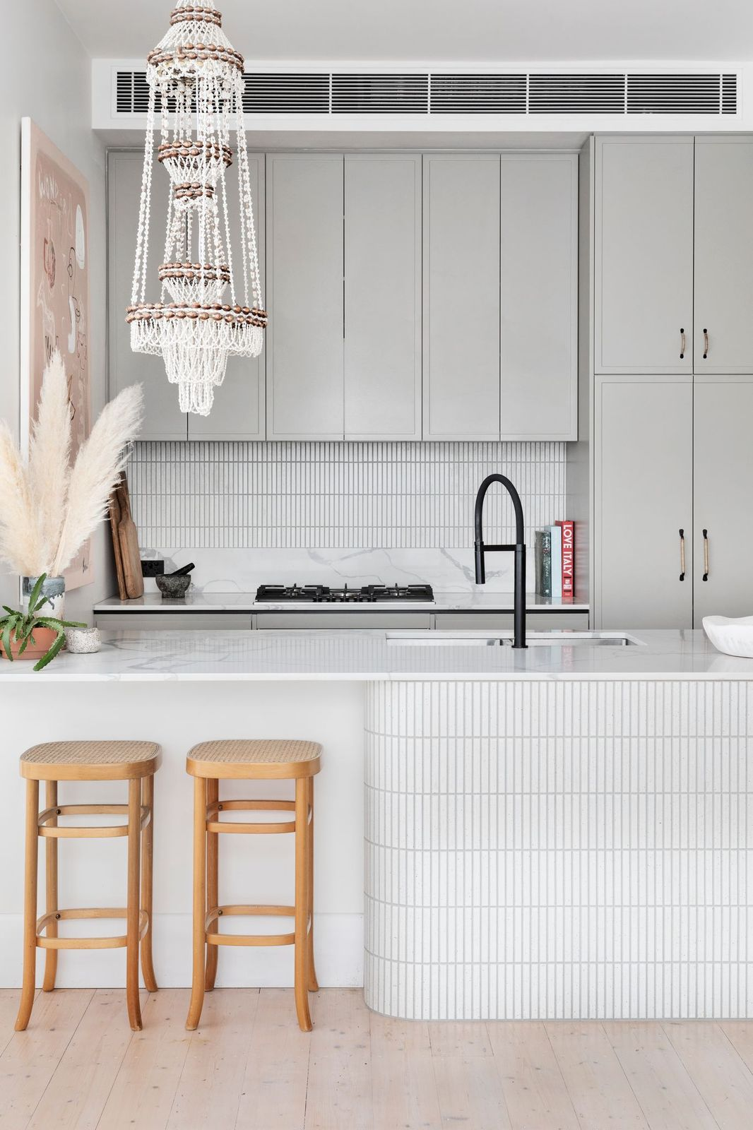 White kitchen with tiled curved bench