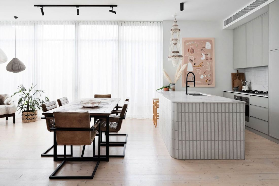 Dining and kitchen space with Bonnie Gray artwork