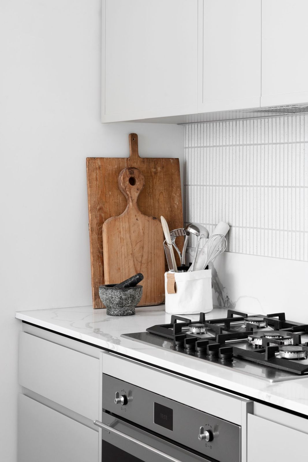 Wooden chopping board vignette in kitchen