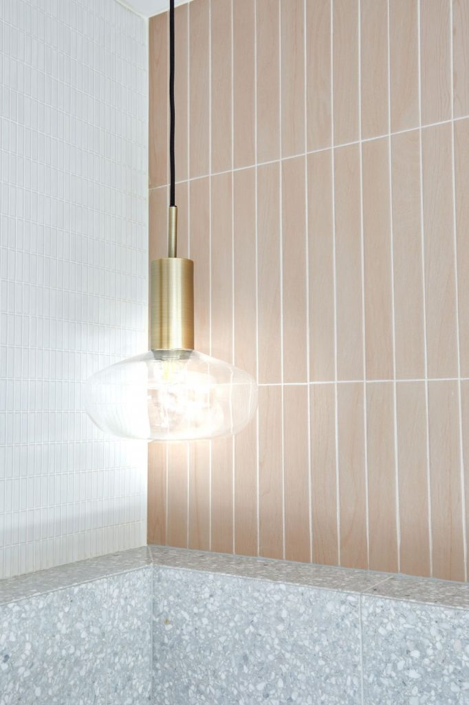 Pink tiles with gold pendant