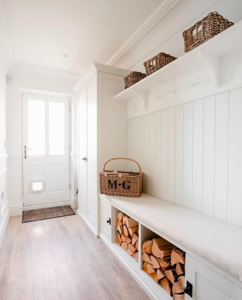 White mudroom with timber cuts and overhead storage baskets