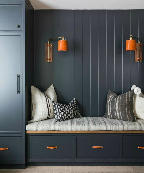 Dark navy panelling with leather accents - mudroom
