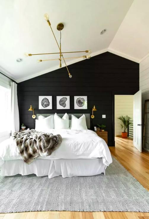 Black shiplap wall in bedroom