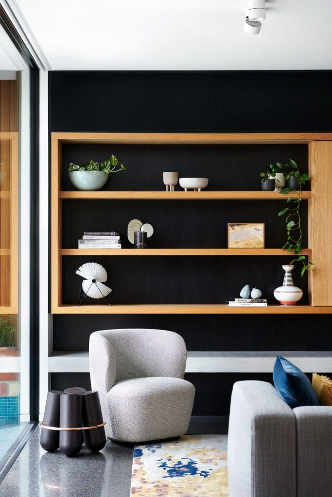 Black and timber shelving unit with display decor