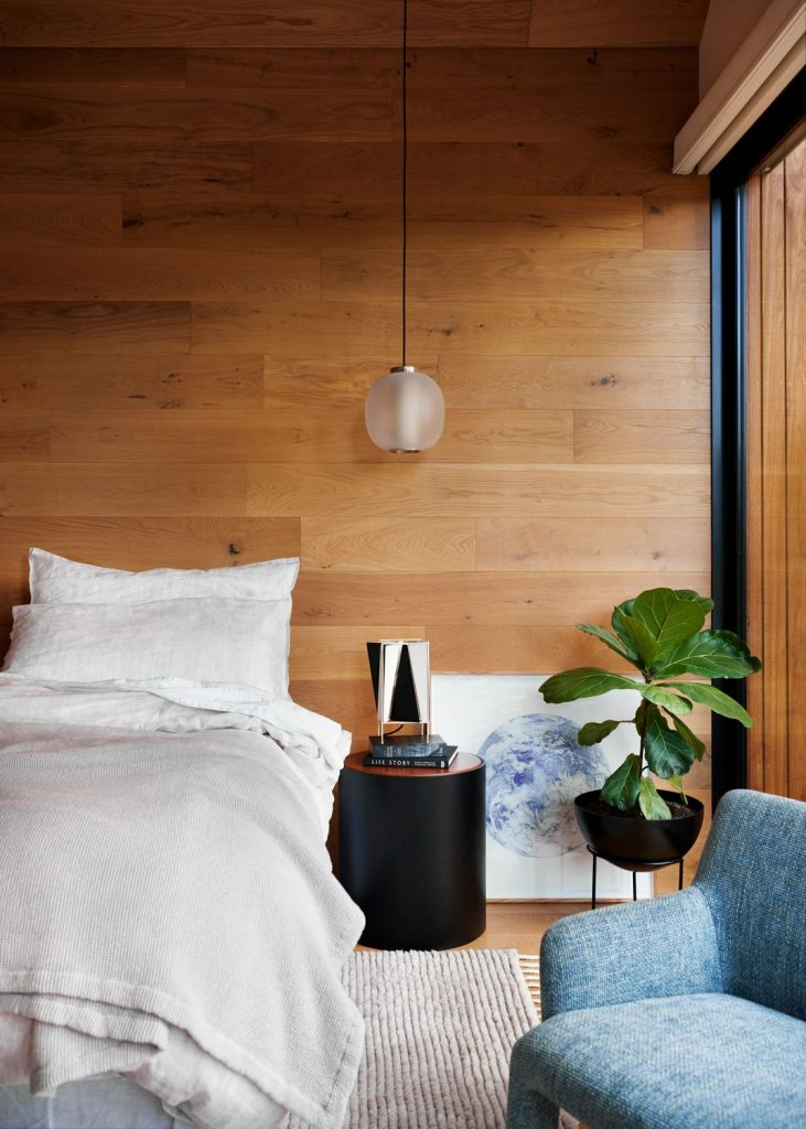 Simple styled bedroom with timber walls