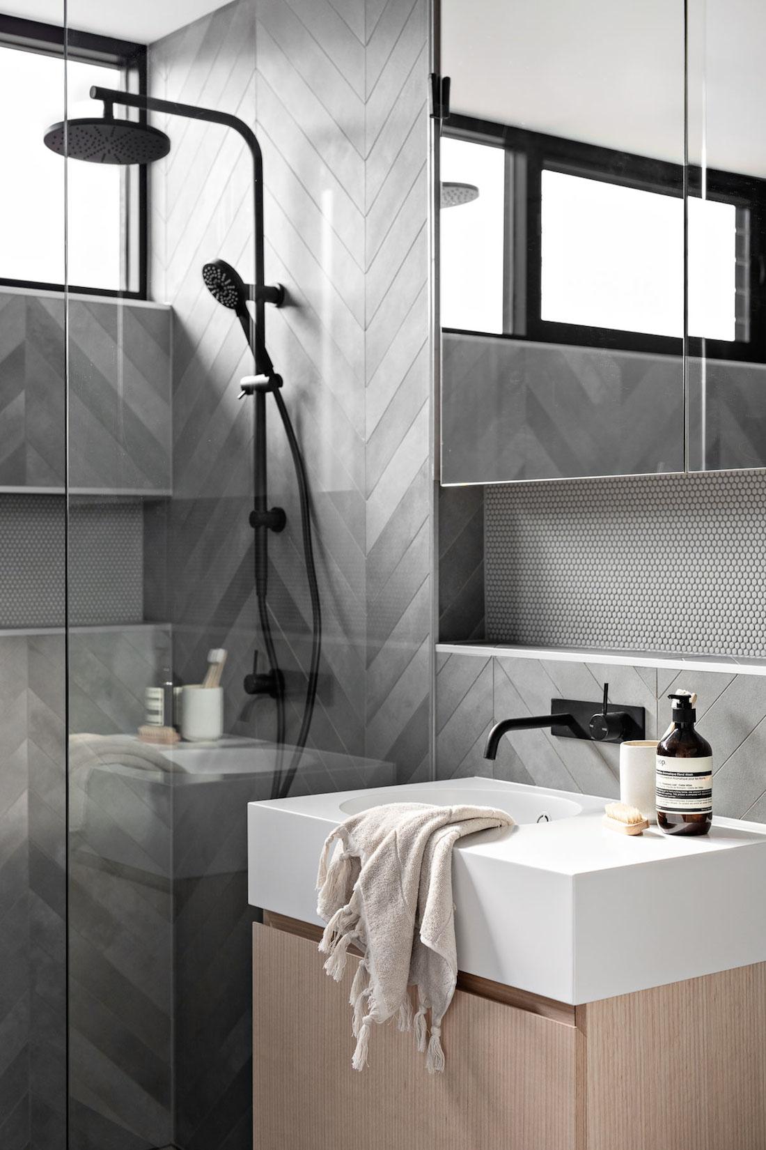 Grey herringbone patterned bathroom