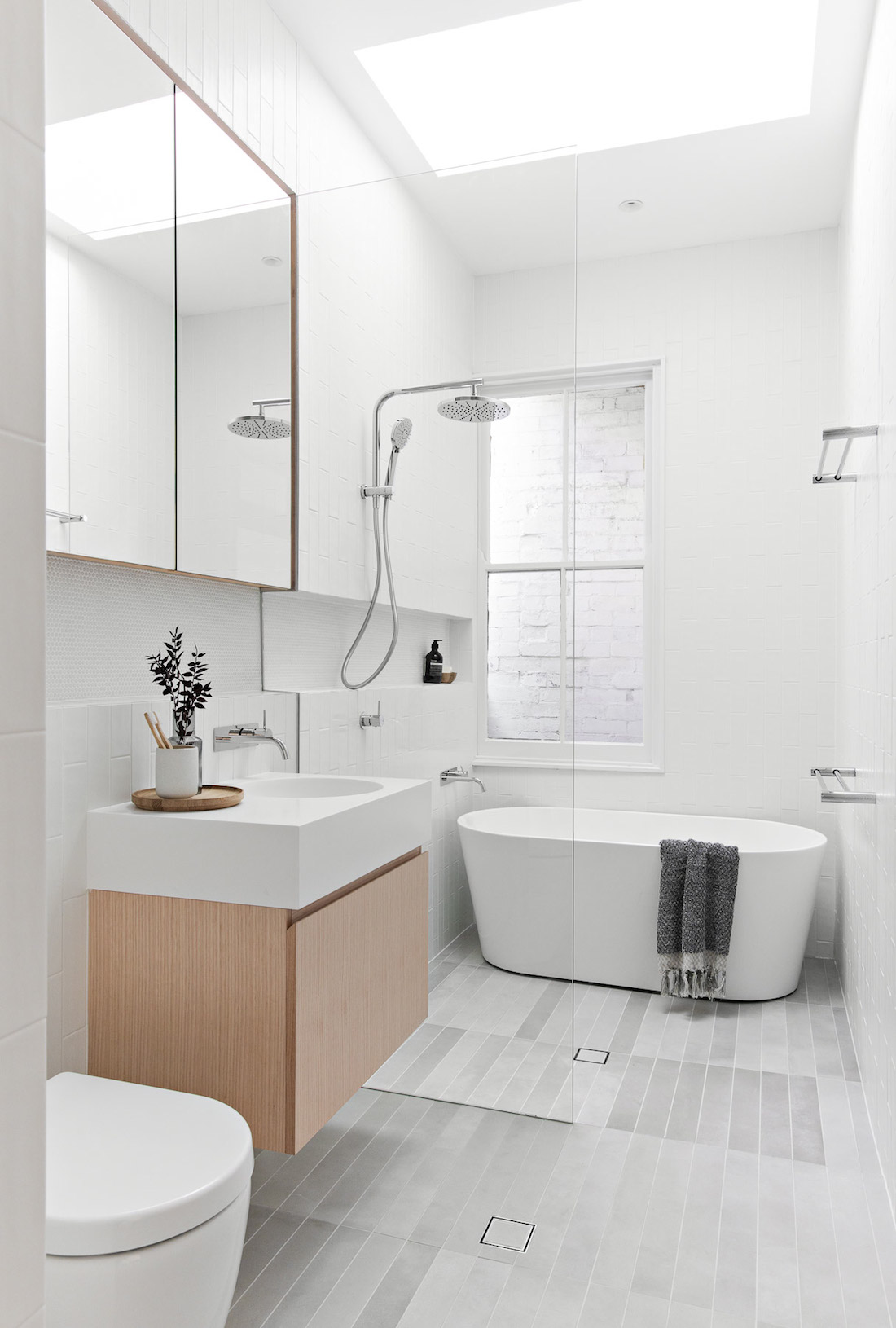 White bathroom with timber accents