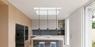 Small kitchen with skylight and grey backsplash
