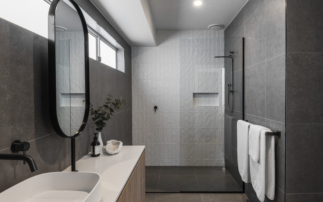 Grey bathroom with textured white tiles