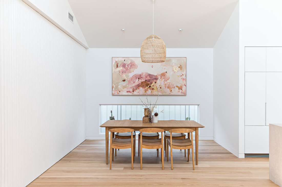 Dining room with art and low level window