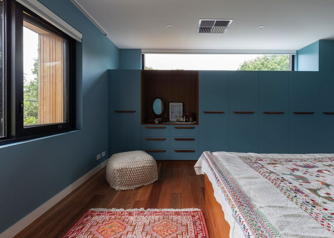 Bedroom with custom blue cabinetry