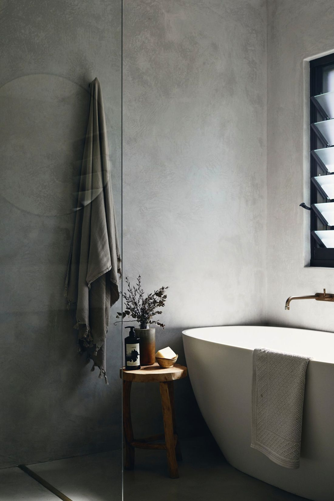 Grey bathroom with freestanding bath