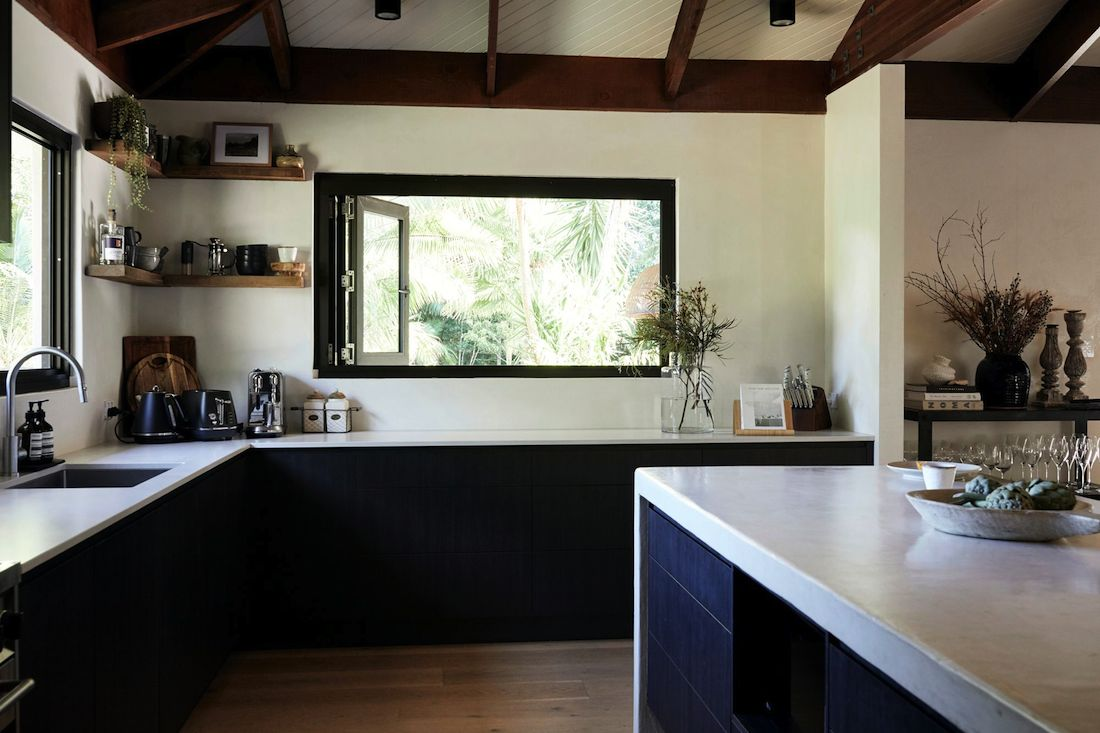 Black and white kitchen with vaulted ceilings