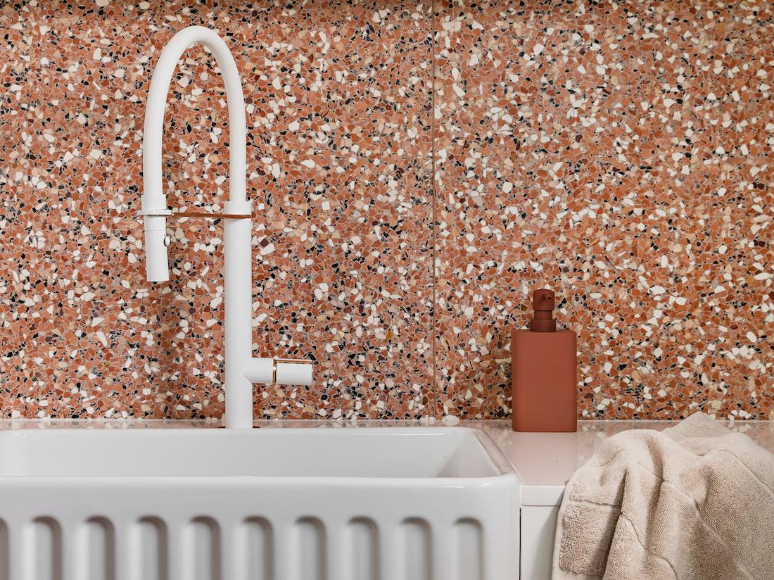 White scalloped farmhouse sink with Terrazzo bathroom with Fibonacci Stone Fatima's Reflection terrazzo