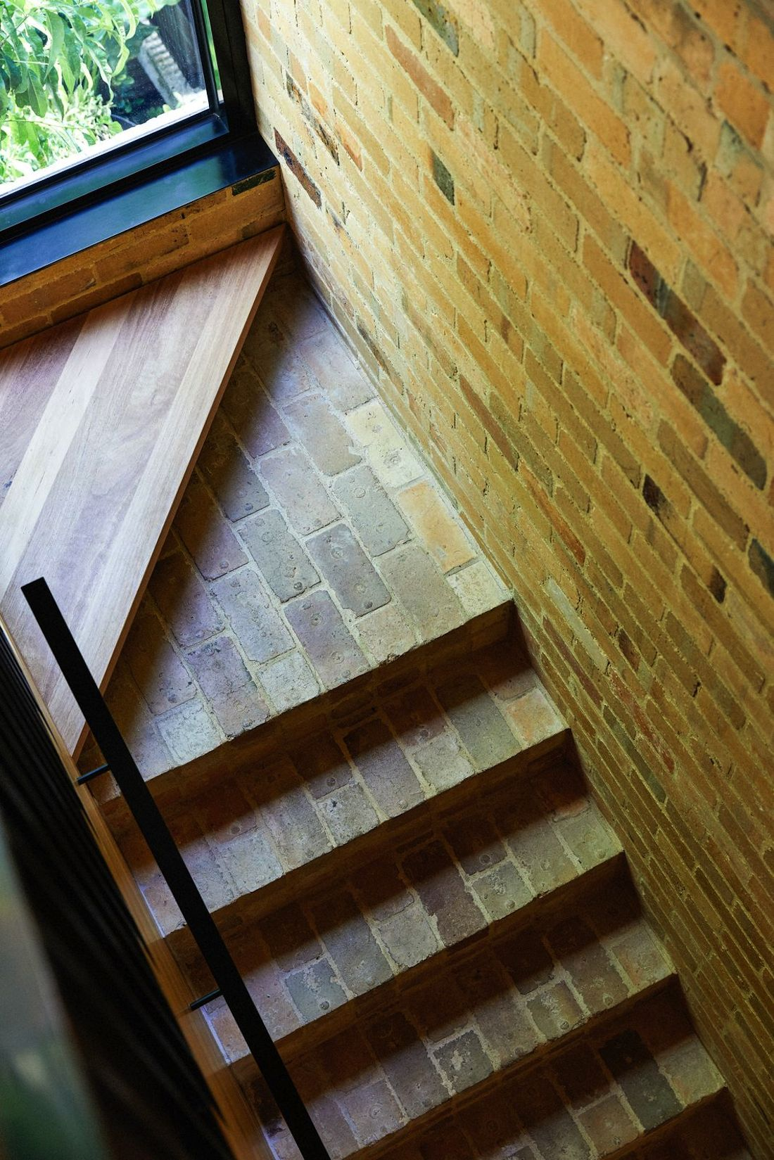 Yellow brick and timber staircase