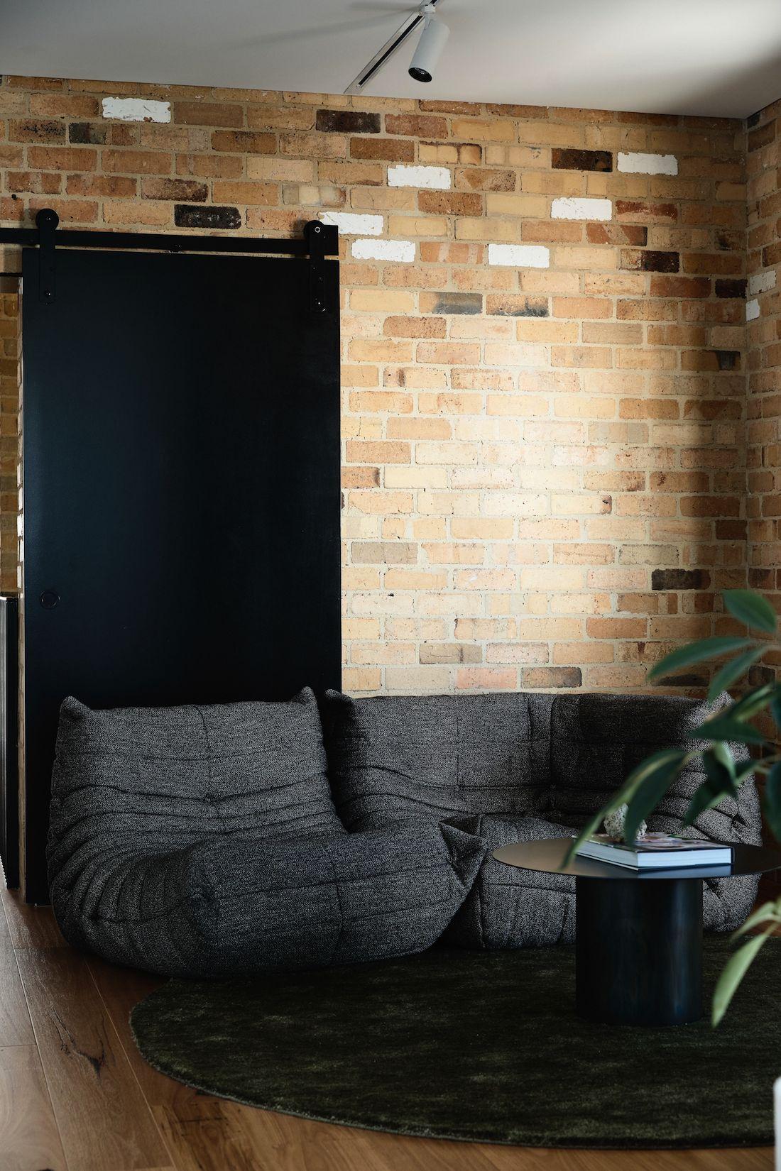 Yellow brick wall with sliding barn door