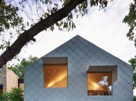 White cladded exterior of Garden House