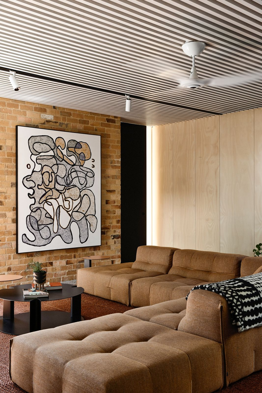 Casual lounge with timber and brick walls