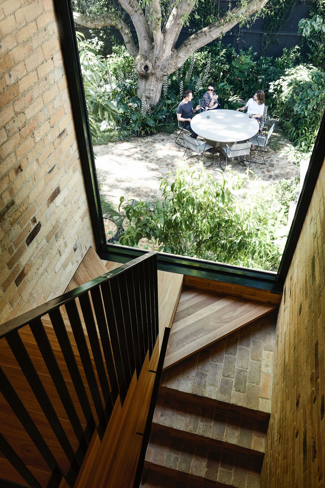 Brick and timber staircase with view