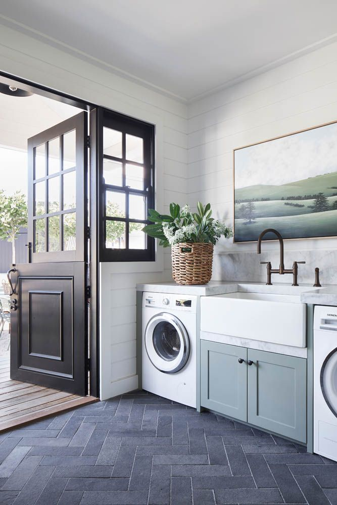 Modern country style laundry with green cabinetry
