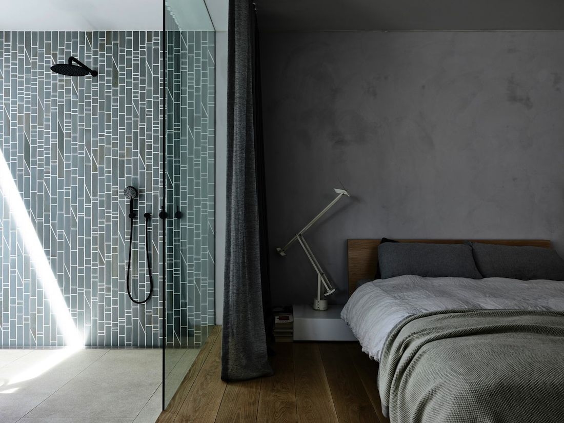 Green tiled ensuite with glass wall