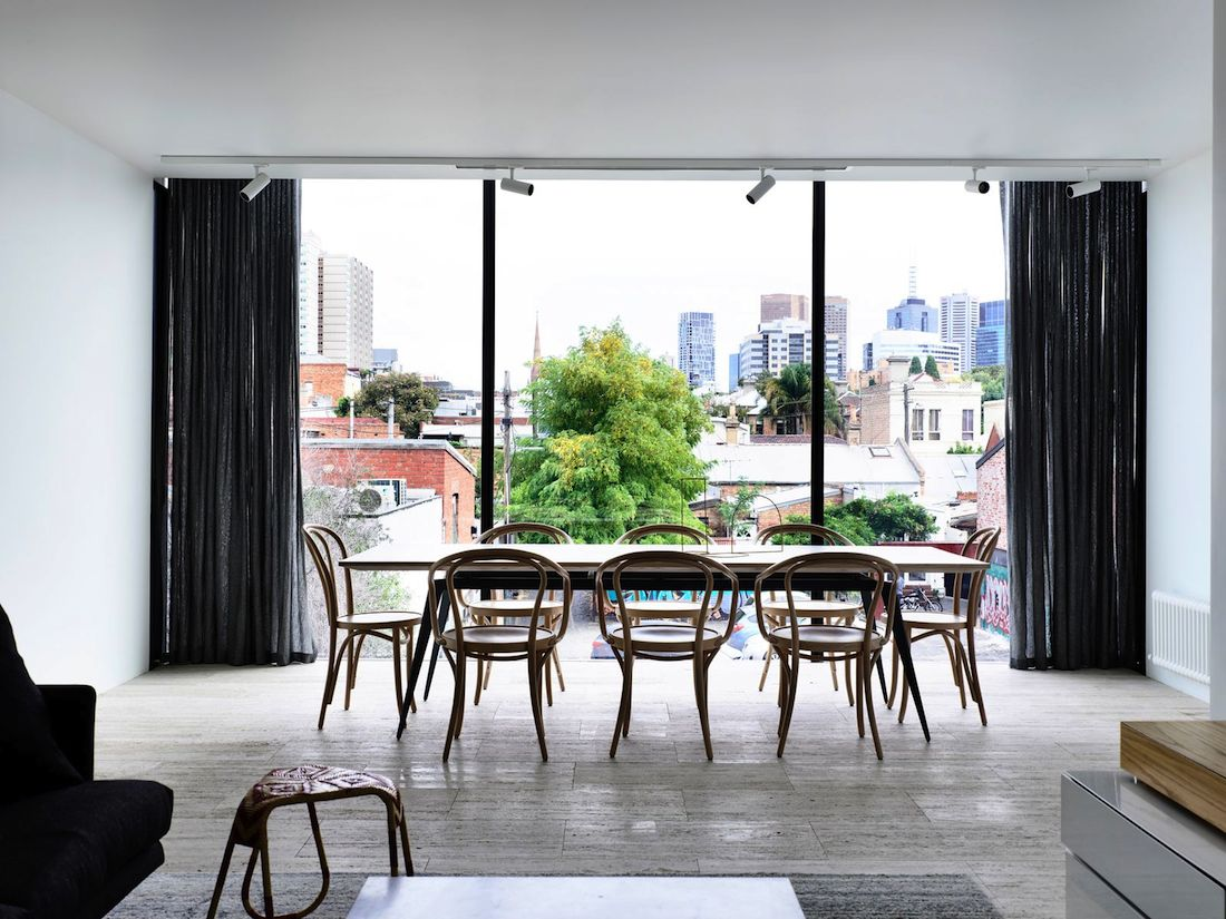 Industrial feel dining room with city view