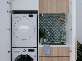 Under-stair laundry with stacked washer dryer