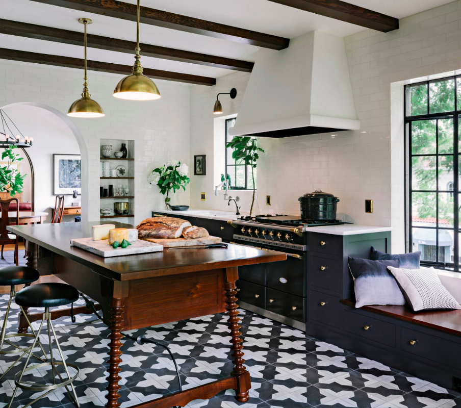 Kitchen with exposed beams and ornate tiles