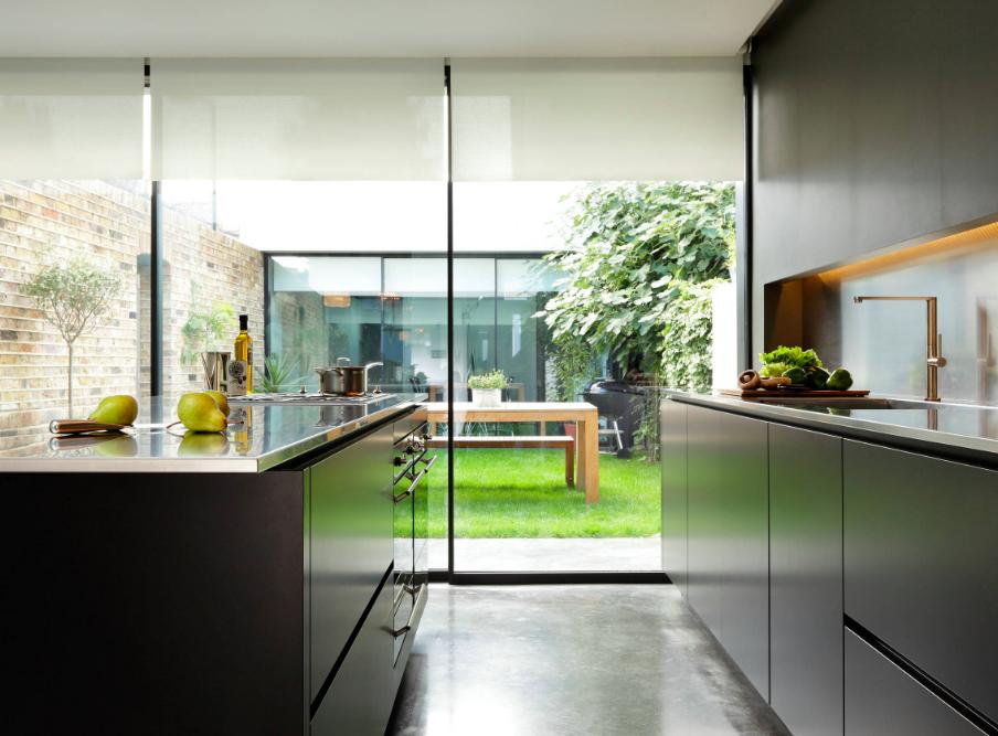 Black polished concrete floors in kitchen