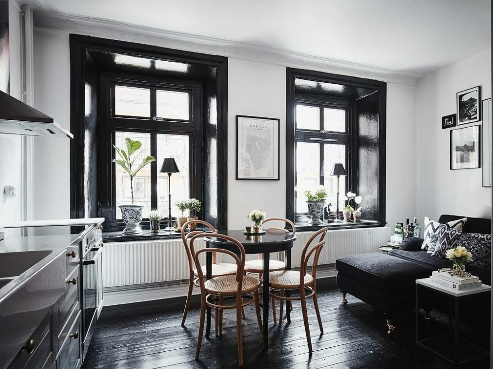Black polished floors in dining space