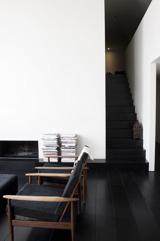 Modern minimalist living room with black floors