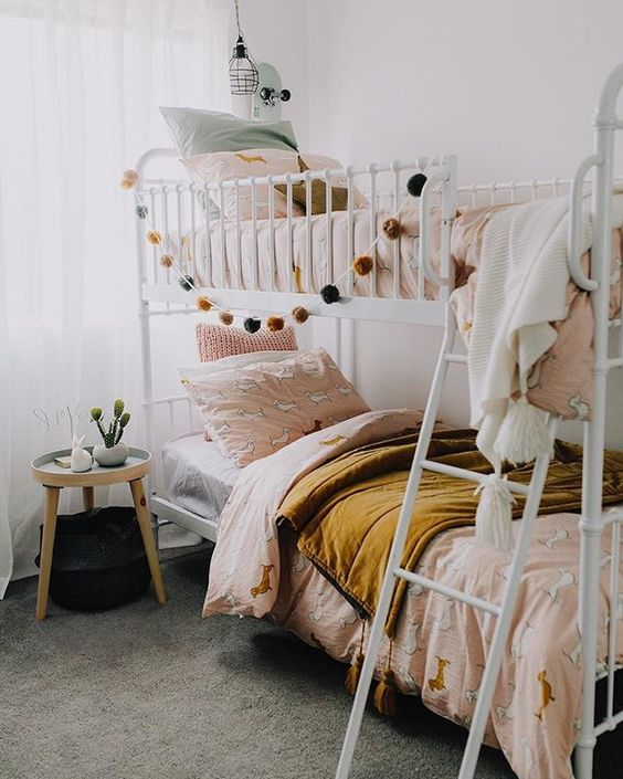 Bunk beds with pompom garland