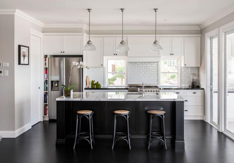 Hamptons kitchen with black floors