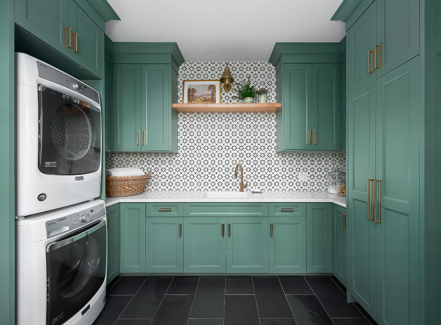 Laundry and mudroom with green cabinetry