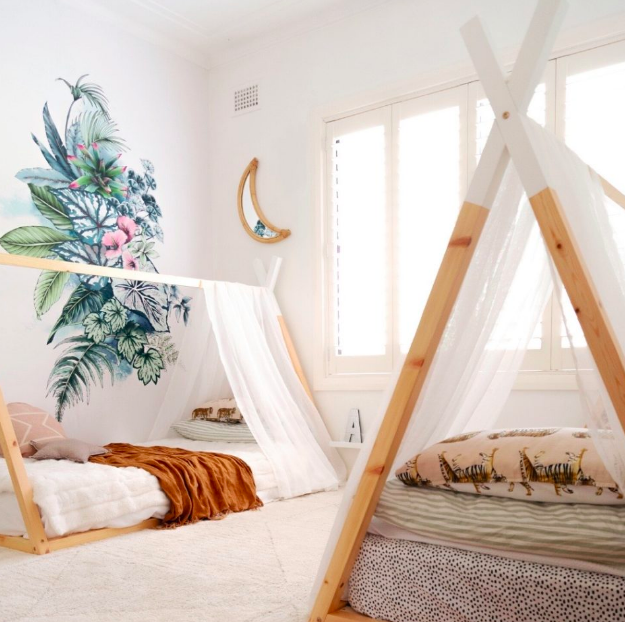 Teepee beds in shared bedroom