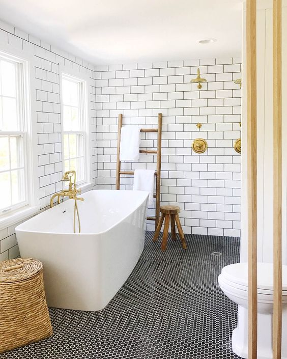 Black and white bathroom with gold accents